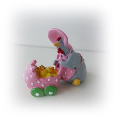 Höna med kycklingar i vagn